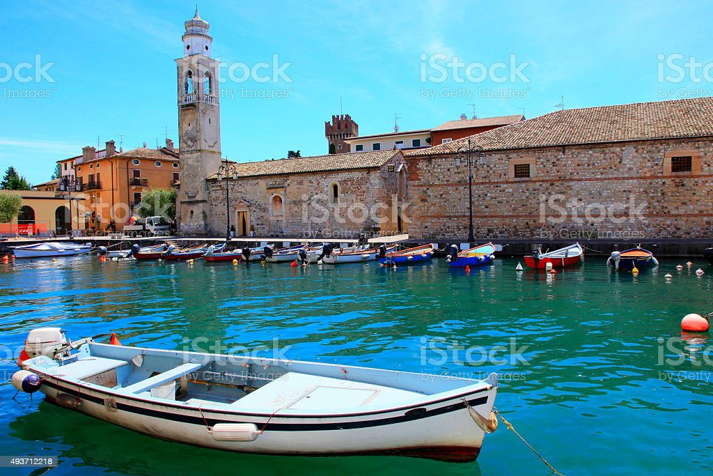 Italian Lazise pier medieval old town, boat, Lake Garda stock photo