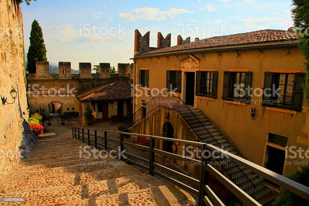 Italian Malcesine medieval old town streets, buildings gold sunset, Garda stock photo