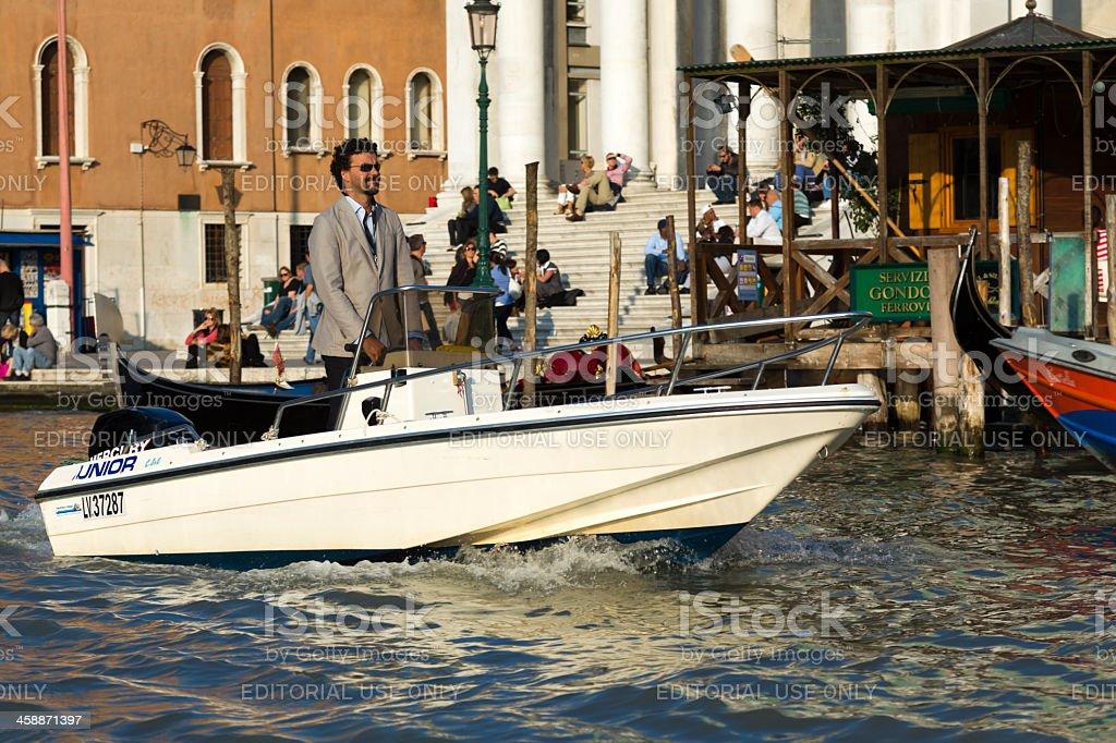 Italian man driving a motor boat royalty-free stock photo