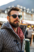 Italian man wearing sunglasses at late afternoon in the city
