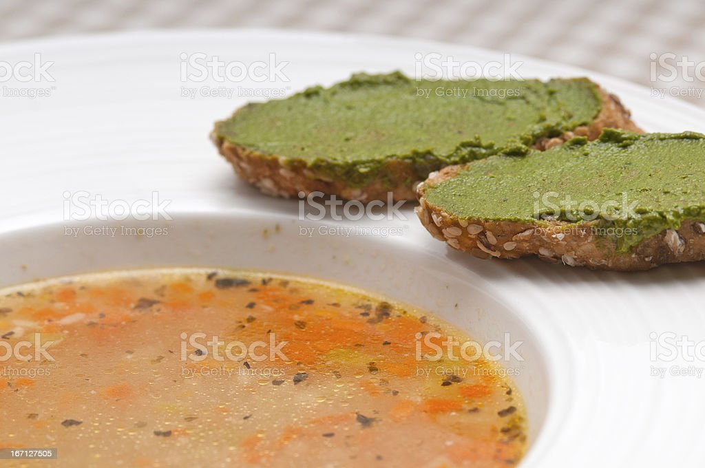 Italian minestrone soup with pesto crostini on side royalty-free stock photo