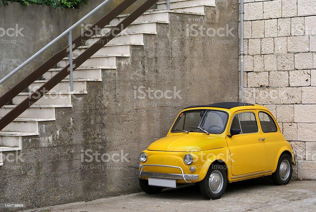 Italian mini car in rustic setting stock photo