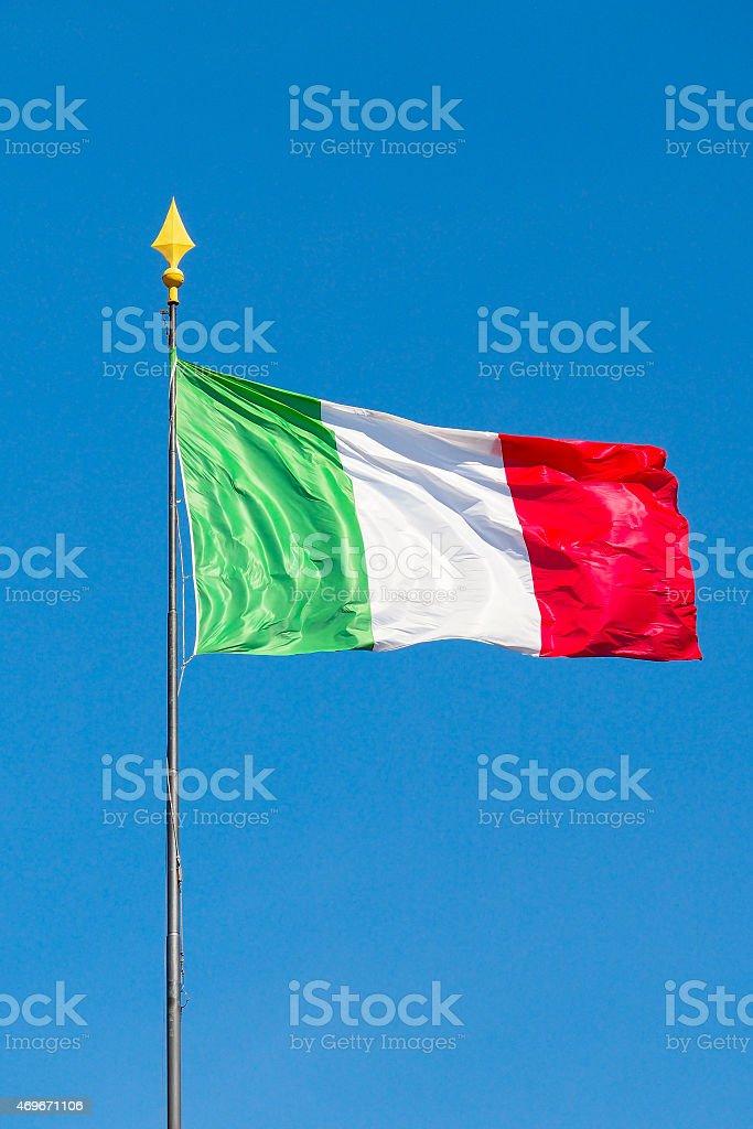 Italian national flag with blue sky stock photo