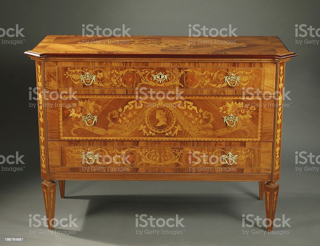 Italian NeoClassical Style Chest of Drawers stock photo