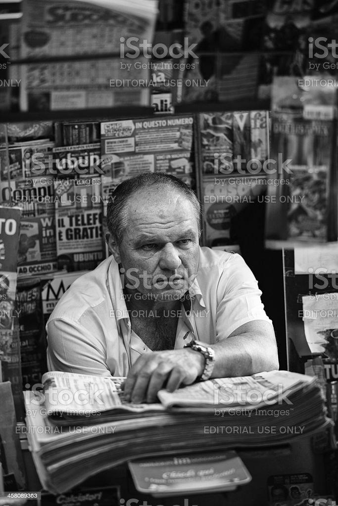 Italian newsagent in his kiosk royalty-free stock photo