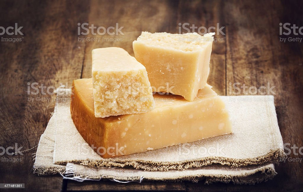 Italian  Parmesan Cheese on Wooden Background close up. stock photo