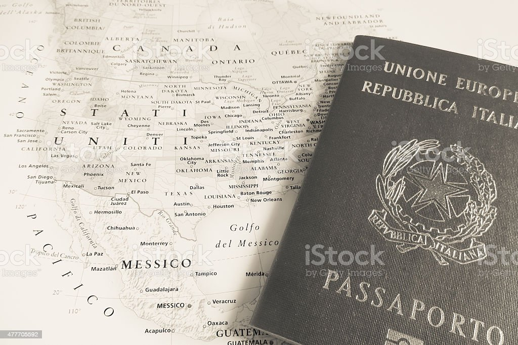 Italian passport over USA map stock photo