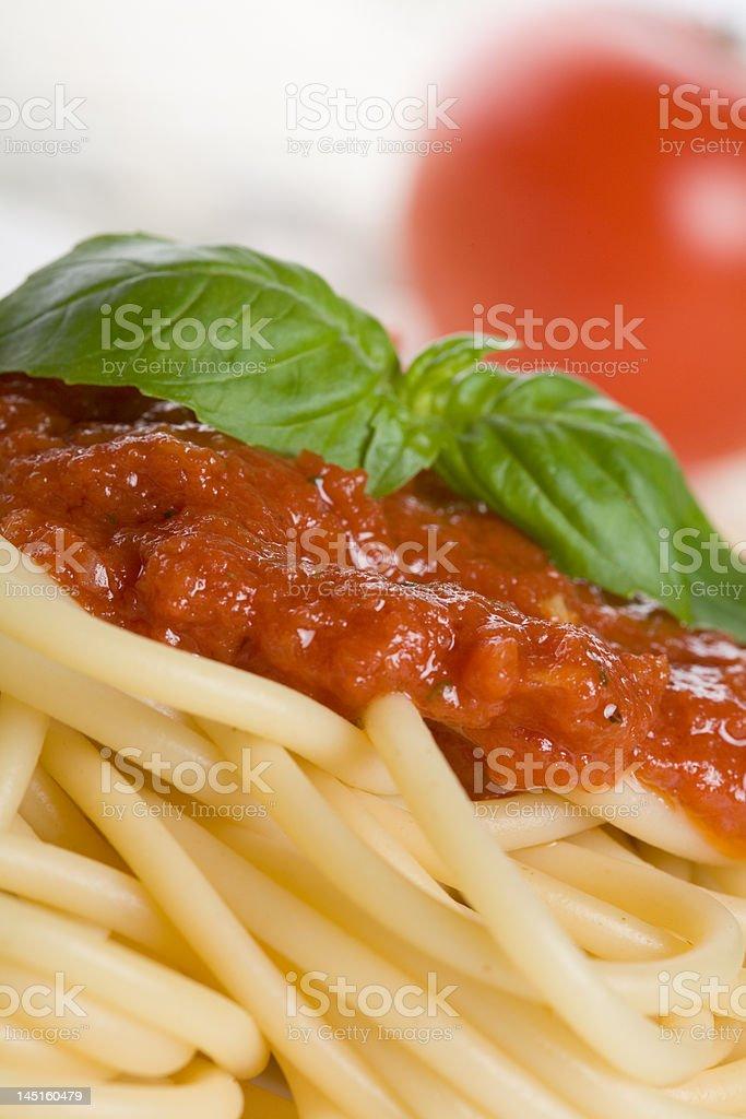 Italian pasta and tomato sauce with herbs royalty-free stock photo