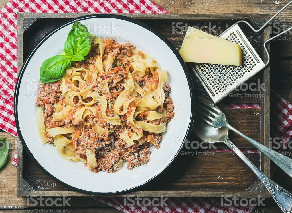 Italian pasta dinner with Parmesan cheese and fresh basil stock photo