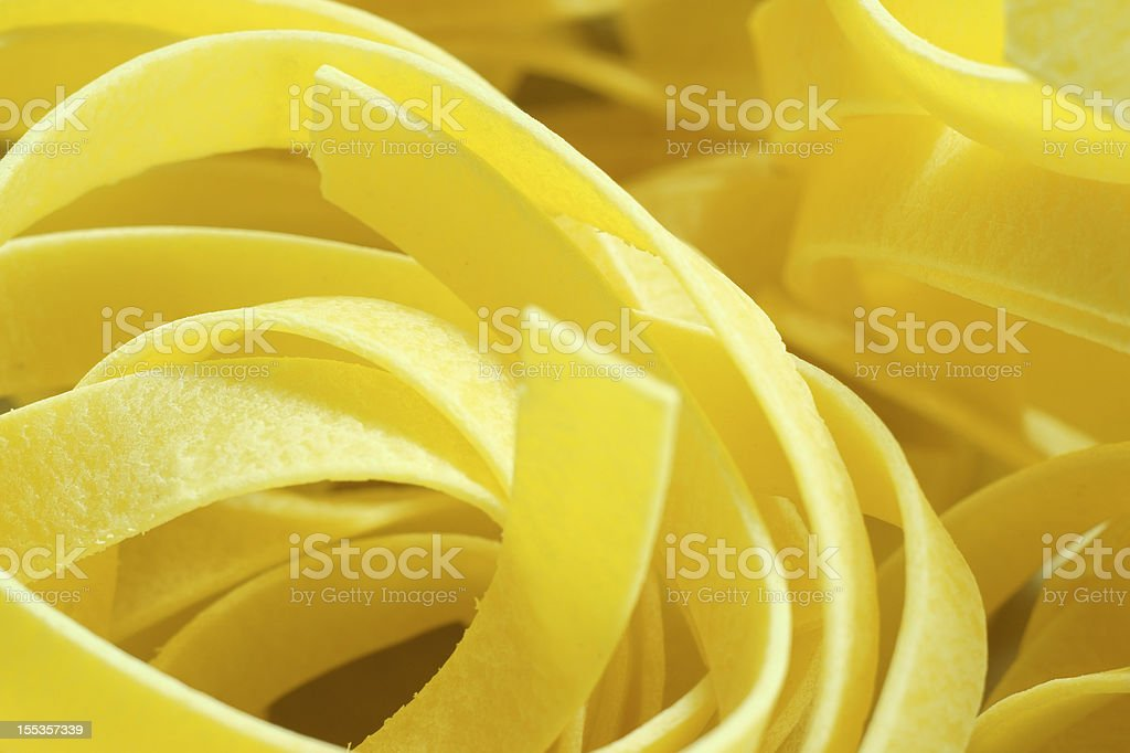 Italian pasta: egg fettuccine stock photo