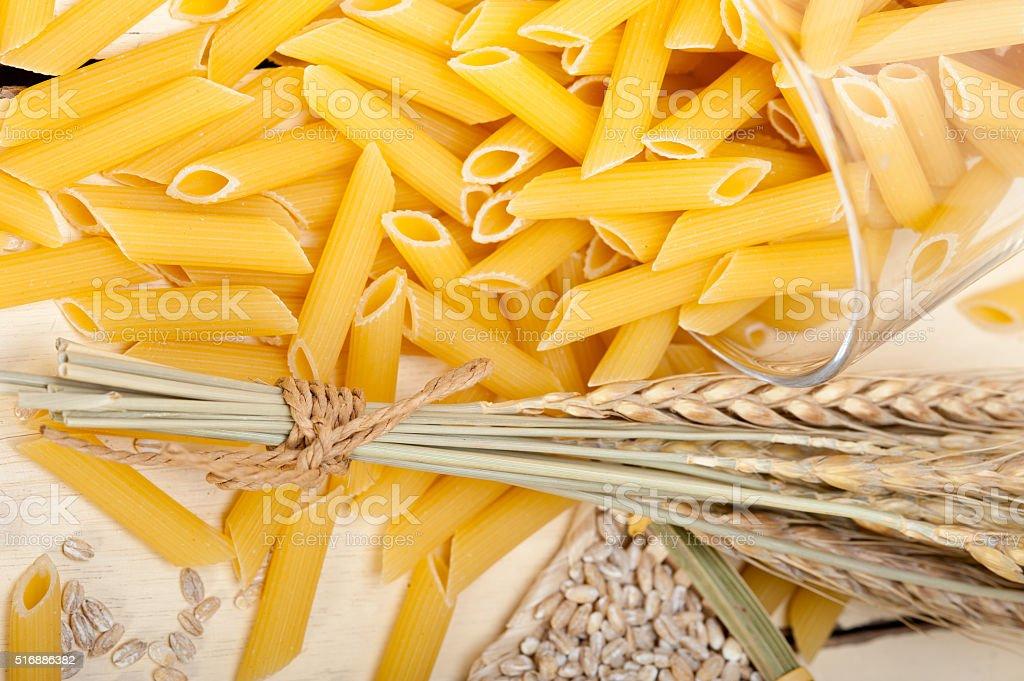 Italian pasta penne with wheat stock photo