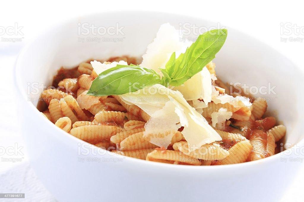 Italian pasta shells with tomato sauce stock photo