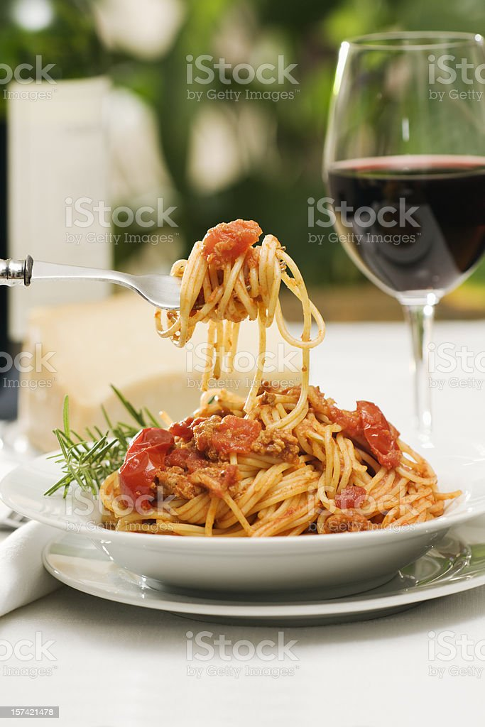 Italian Pasta Spaghetti Bolognese Dinner with Wine and Bottle stock photo