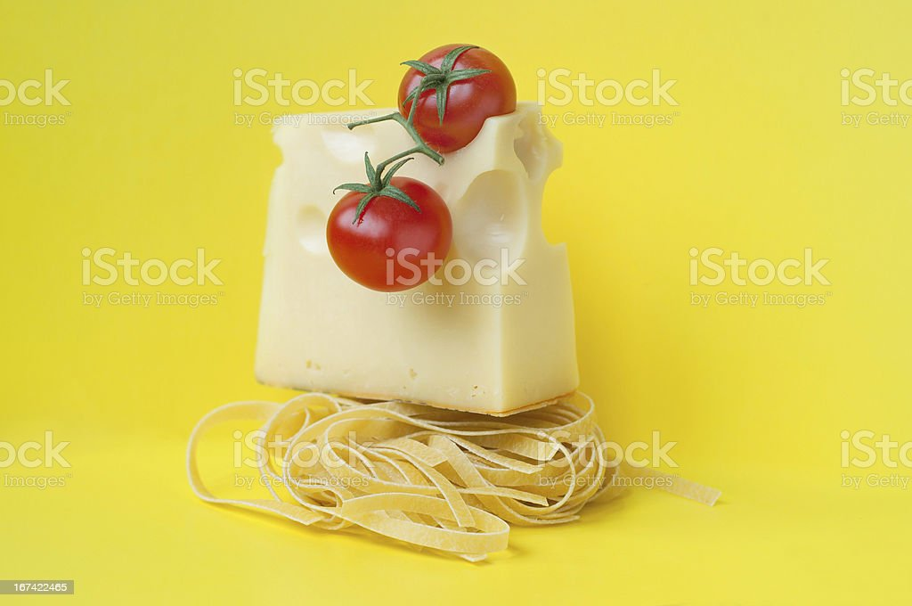 Italian pasta with cheese and tomatoes royalty-free stock photo