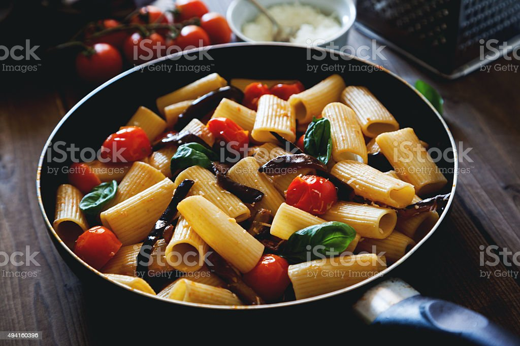 italian pasta with cherry tomato eggplant and basil stock photo