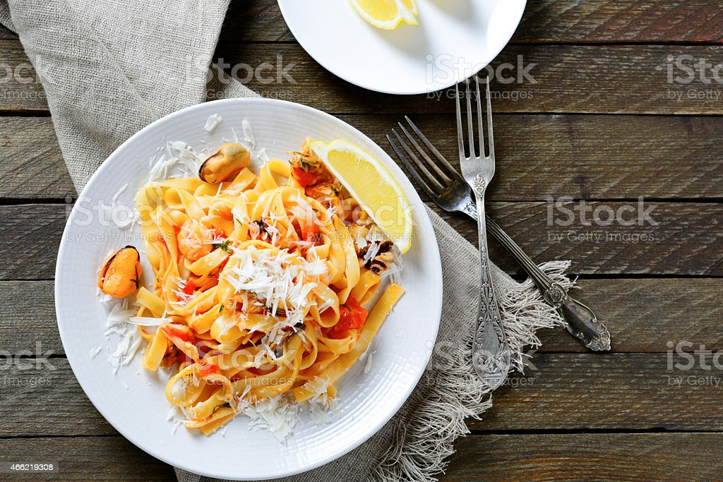 Italian pasta with seafood on a white plate stock photo