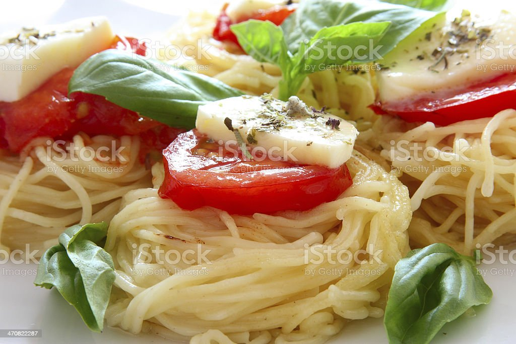 Italian pasta with tomatoes and cheese stock photo