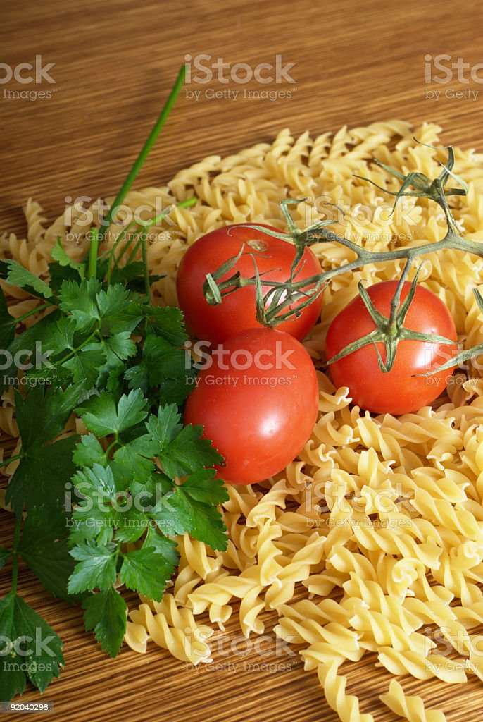 Italian Pasta with Tomatoes and Herbs on Old Wooden Table royalty-free stock photo