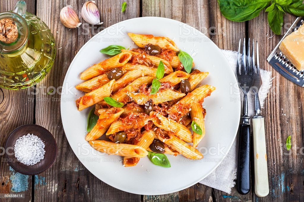 Italian penne pasta with tomato sauce stock photo