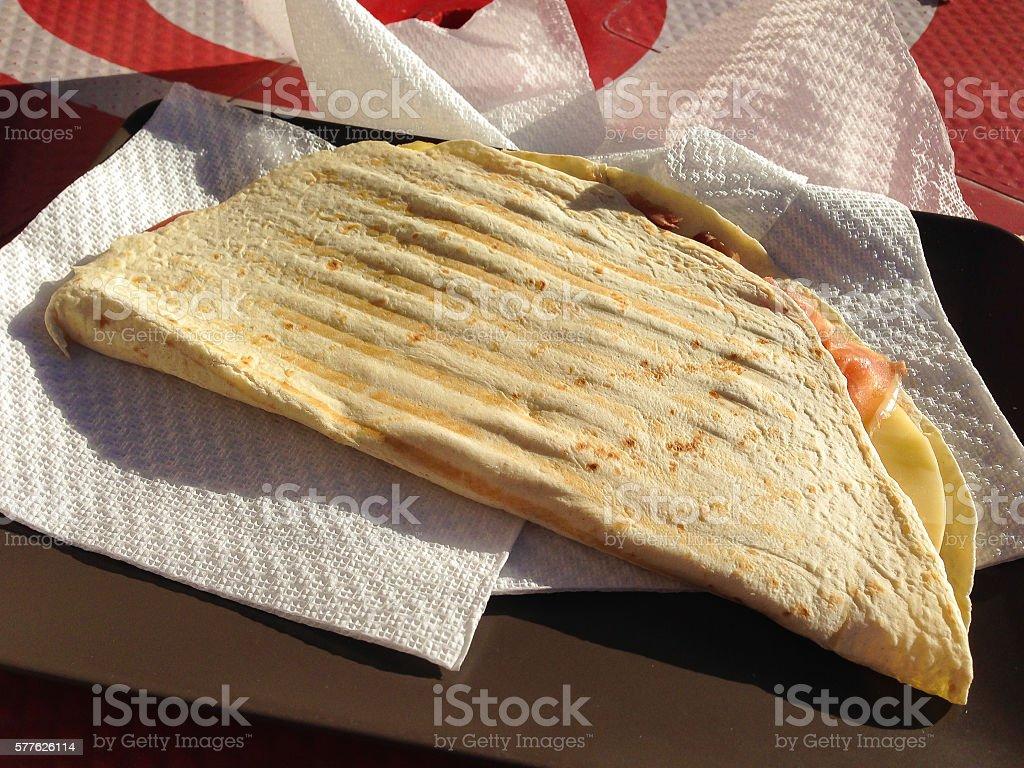 Italian piadina with ham and cheese stock photo