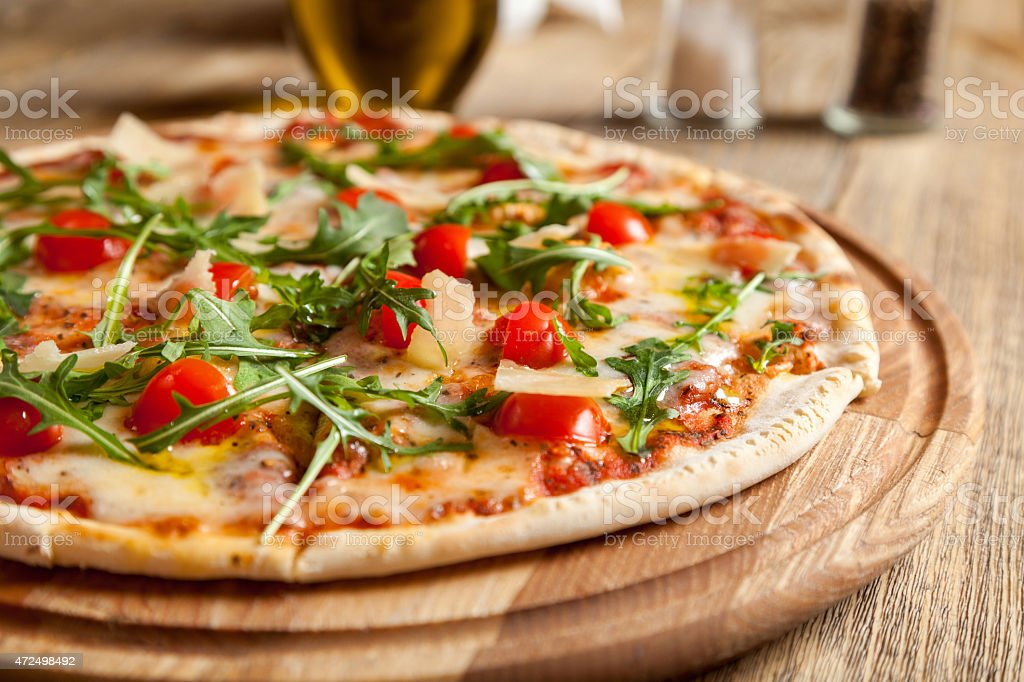 Italian pizza 'Caprese' on a wooden table. stock photo