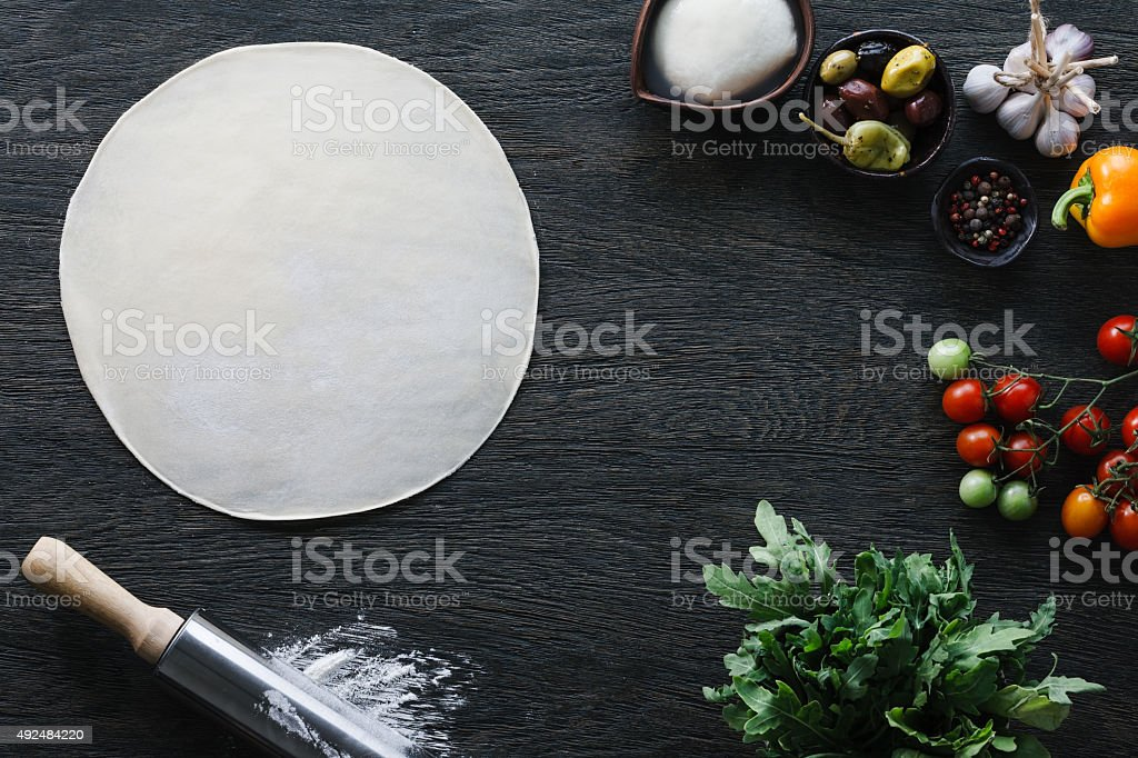 Italian pizza cooking stock photo