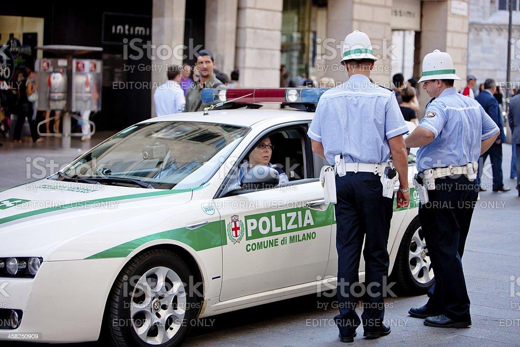 Italian Policemen talking on Piazza Del Duomo, Milan royalty-free stock photo