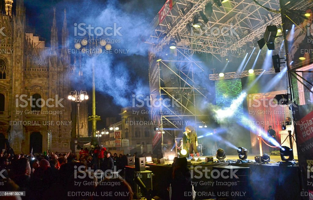 Italian popular rapper Caparezza is singing in Milan Duomo square. stock photo
