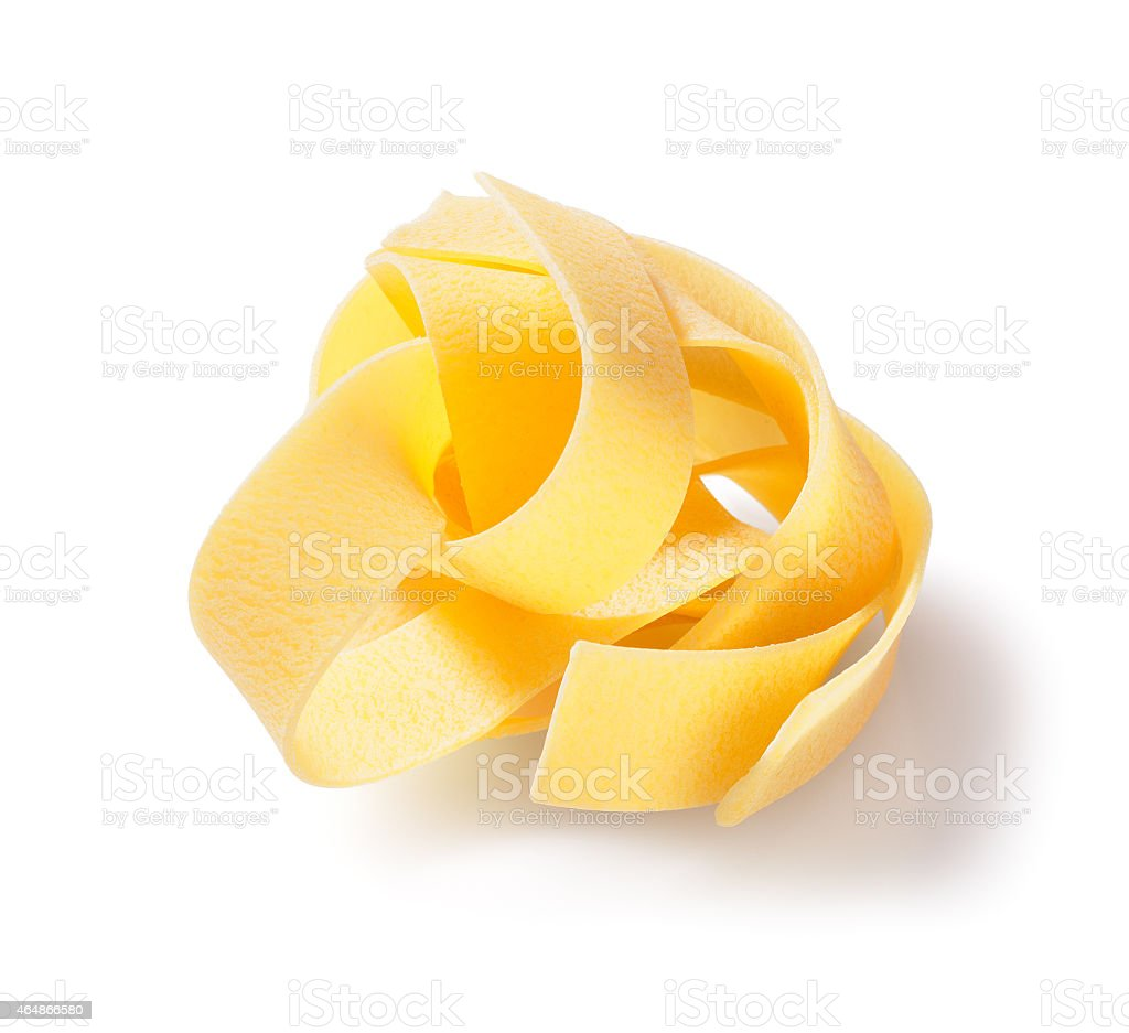 Italian raw pasta, pappardelle, on white background stock photo