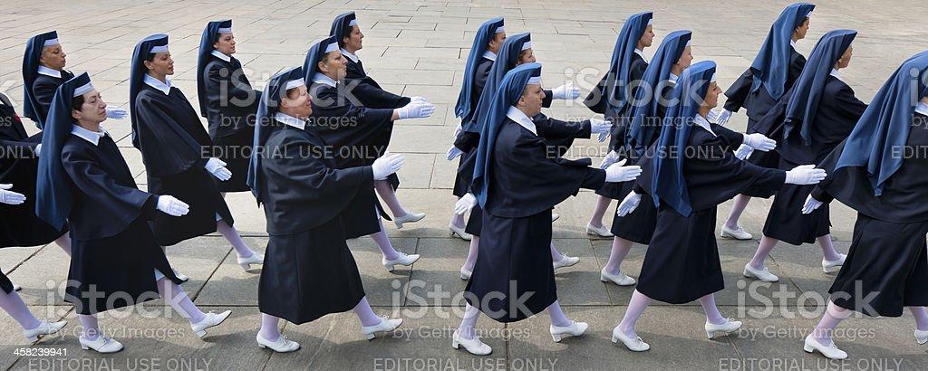 Italian Red Cross volunteer nurses in a national parade, Turin royalty-free stock photo