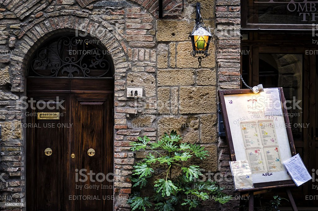 Italian restaurant and pizzeria in the ancient streets of Volterra royalty-free stock photo