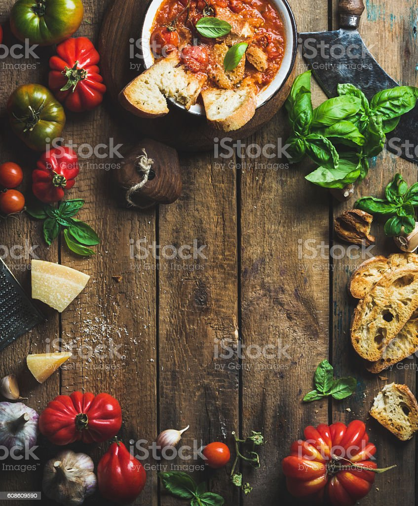 Italian roasted tomato and garlic soup with bread, basil, parmesan stock photo