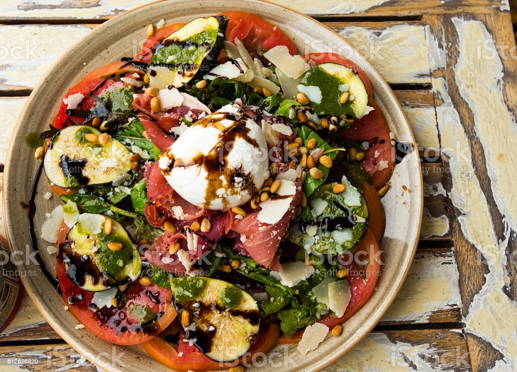 Italian salad with bocconicini and figs stock photo