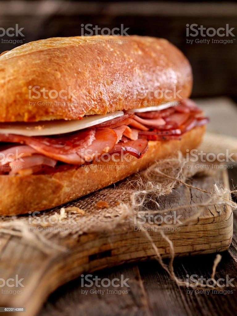 Italian Sandwich with Salami,Genoa, Prosciutto and Provolone stock photo