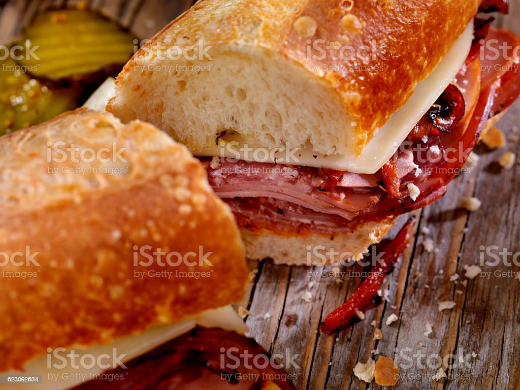 Italian Sandwich with Salami,Genoa, Prosciutto, Provolone and Red Peppers stock photo
