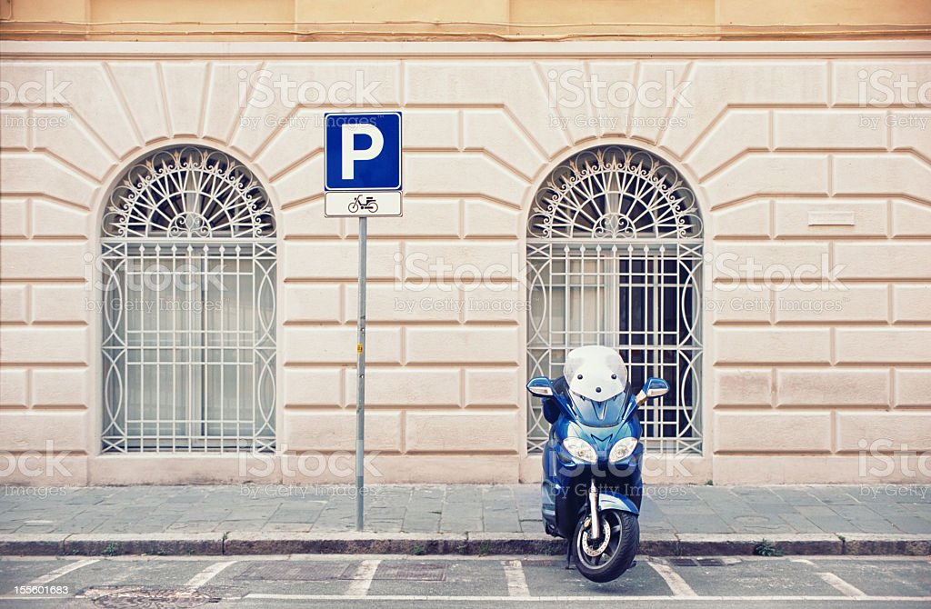 Italian scooter parked on the street stock photo