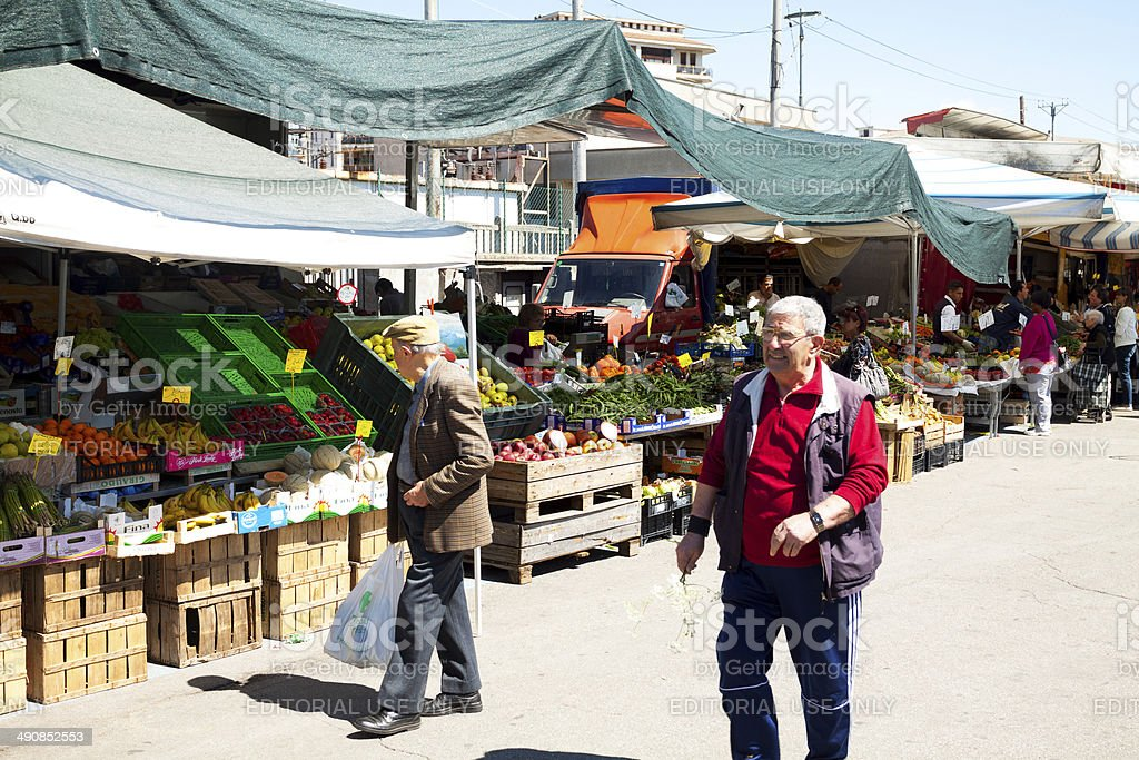 Italian senior men on market royalty-free stock photo