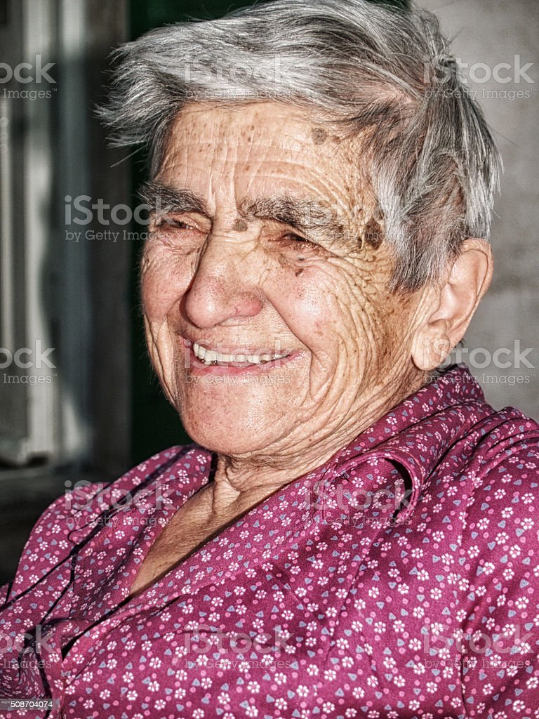 Italian Senior Woman w a huge smile. stock photo