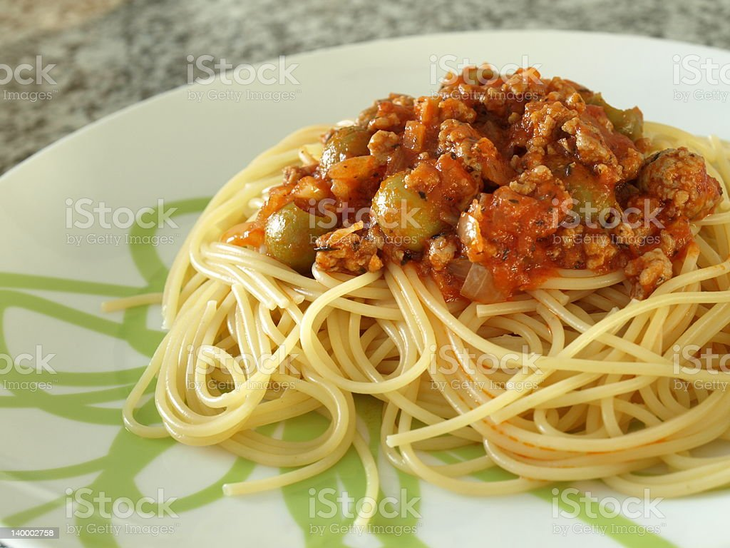 Italian spaghetti bolognese with olives royalty-free stock photo