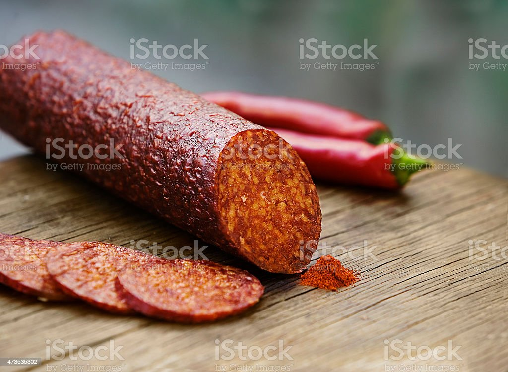 italian spicy salami sausage on wooden board stock photo