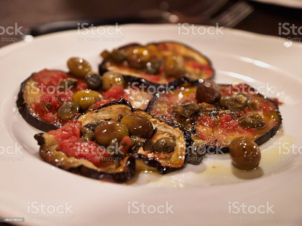 Italian stater dish eggplant with olives stock photo
