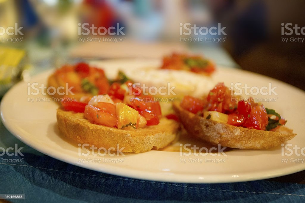 italian stater of tomato and olive oil bruschetta stock photo