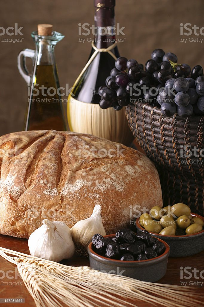 Italian Still Life with Wine, Bread, Grapes, Olives & Garlic stock photo