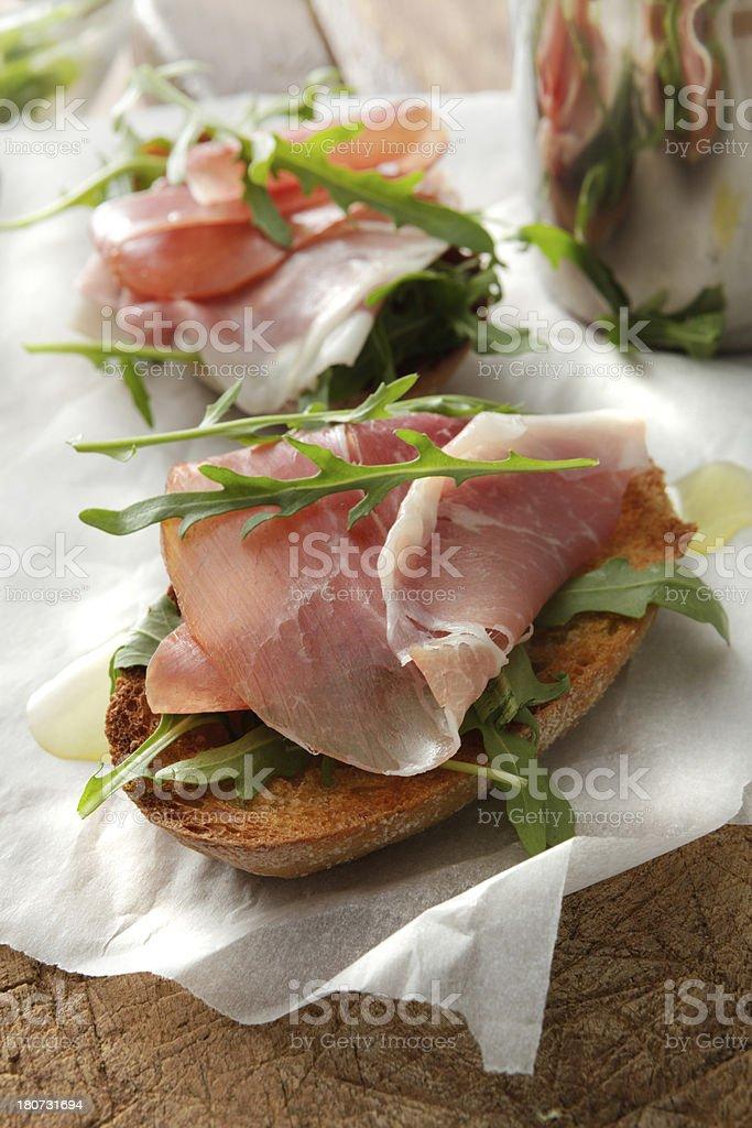 Italian Stills: Bruschetta with Parma Ham and Arigula stock photo