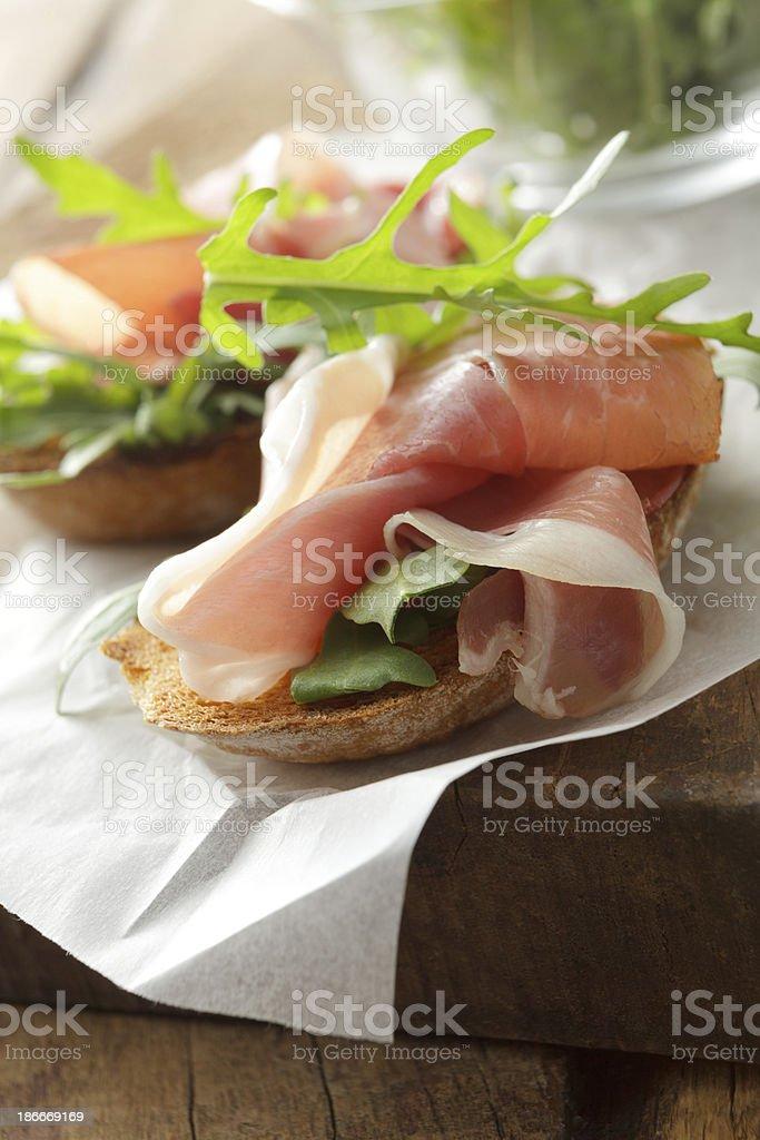 Italian Stills: Bruschetta with Parma Ham and Arigula royalty-free stock photo