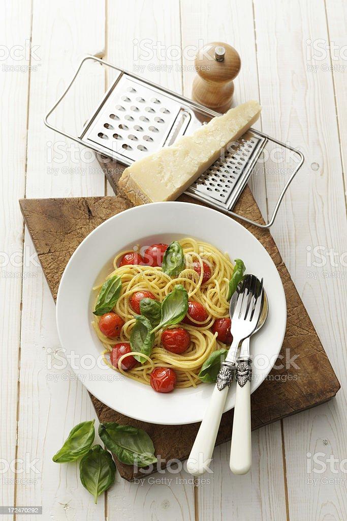 Italian Stills: Spaghetti with Cherry Tomatoes and Basil royalty-free stock photo