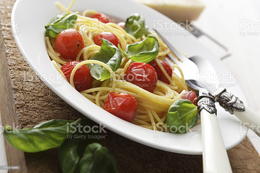 Italian Stills: Spaghetti with Cherry Tomatoes and Basil royalty-free stock photo