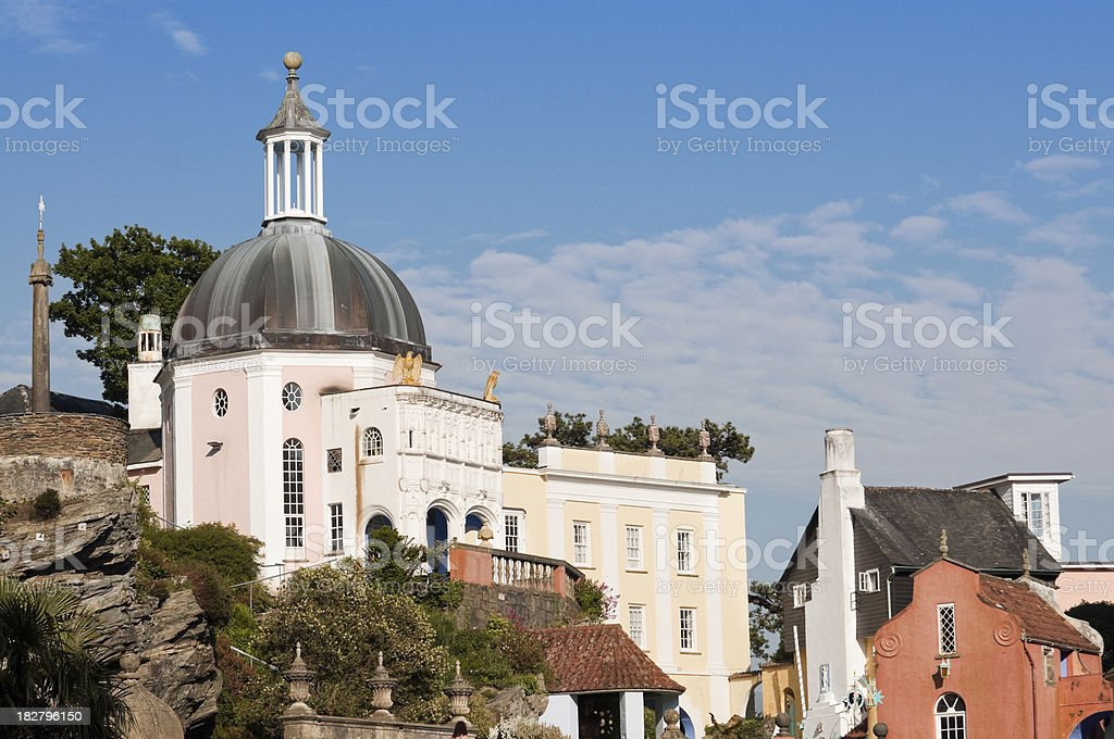 Italian style buildings built into rock face Portmeirion royalty-free stock photo