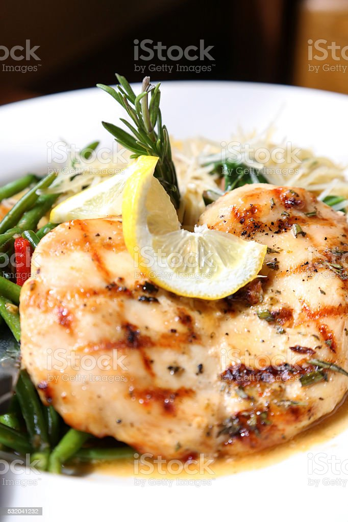 Italian Style Lemon Rosemary Chicken With Green Beans And Pasta stock photo