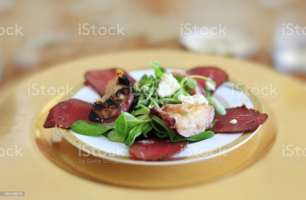 Italian Style Salad with Smoked Bresaola, Grilled Pear and Fetta stock photo